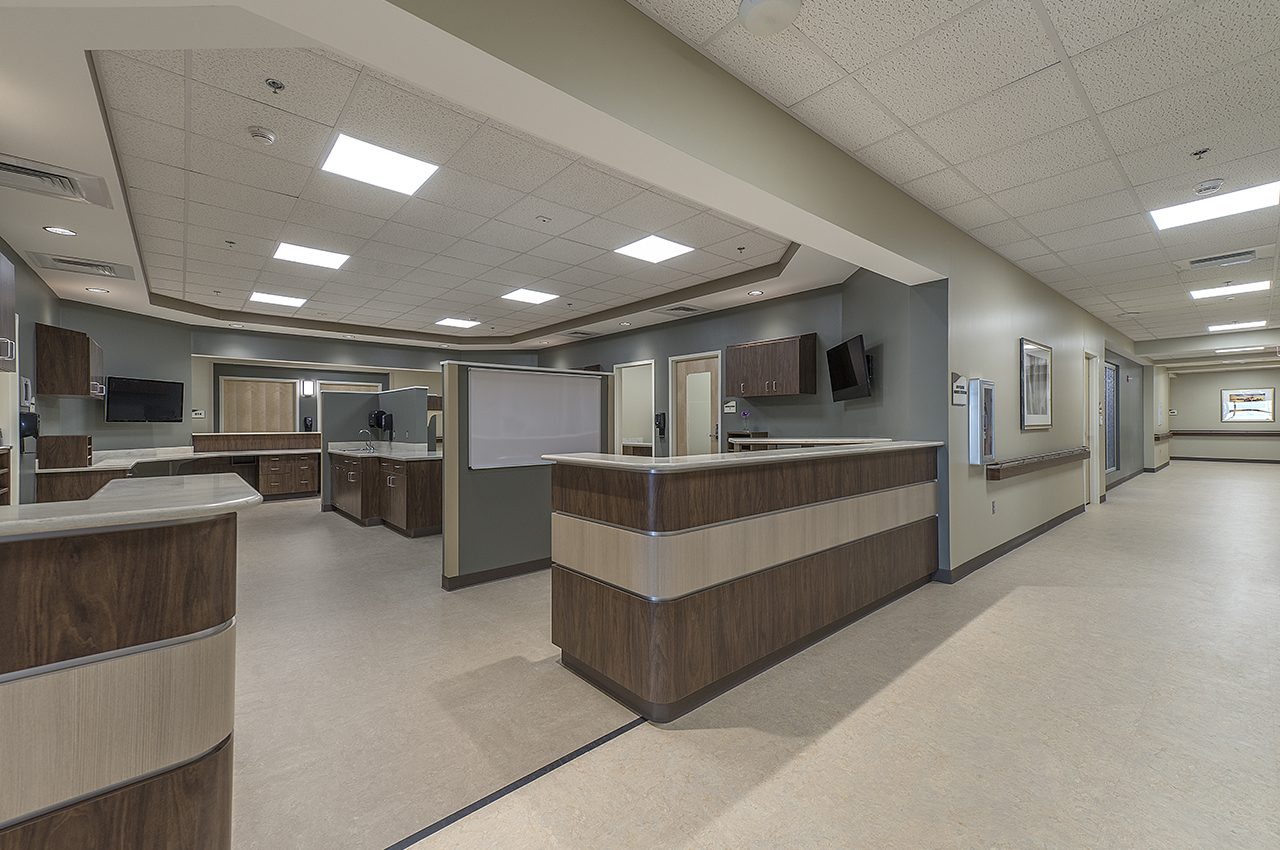 5th floor expansion's nurse station with wood detail and calming color palette