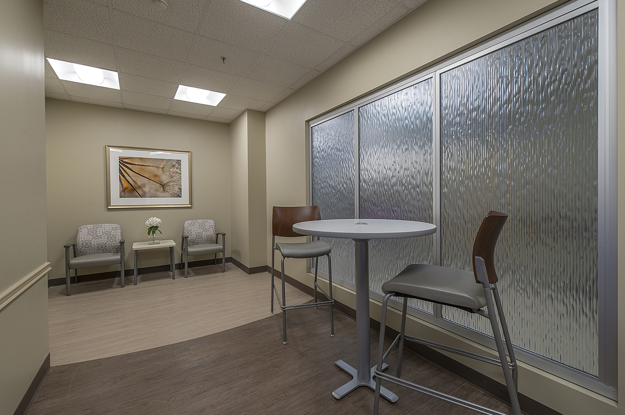 5th floor break area for families and guests includes textured glass window and artwork