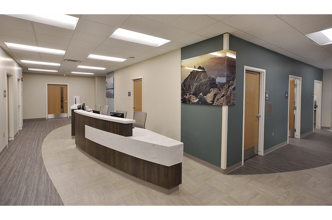 total healthcare nurse station at russell medical center which provides colorful wayfinding via photography