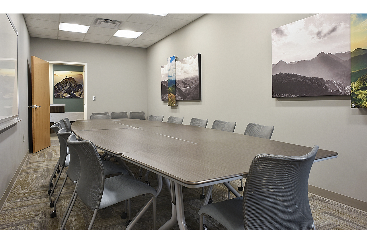 total healthcare board room at russell medical center with global seating and abstract photography